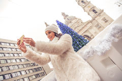 Young woman on the christmas market Royalty Free Stock Images
