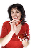 Young woman with Christmas praline Stock Photography