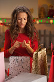 Young woman in christmas preparations Stock Photo