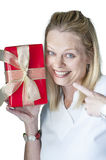 Young woman with Christmas present Stock Photos