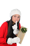 Young Woman with Christmas Present going shh Royalty Free Stock Photo
