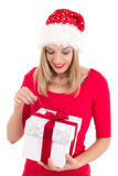 Young woman with Christmas present isolated on white background Royalty Free Stock Photo