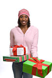 Young woman with Christmas presents royalty free stock images