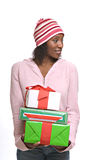 Young woman with Christmas presents. Happy young African-American woman holding Christmas presents royalty free stock photography