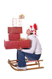 Young woman with christmas presents on sledge Stock Photography