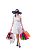 The young woman with christmas shopping bags on white Royalty Free Stock Photography