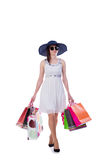 The young woman with christmas shopping bags on white Stock Image