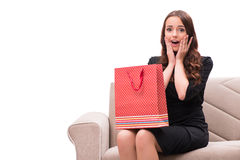 The young woman after christmas shopping on white. Young woman after christmas shopping on white Stock Photography