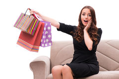The young woman after christmas shopping on white. Young woman after christmas shopping on white Royalty Free Stock Images