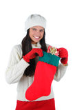 Young Woman with Christmas Stocking Royalty Free Stock Photos