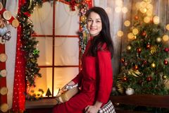 Young woman in a christmas studio Stock Image