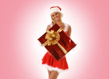 A young woman in a Christmas suit with a present Stock Photo