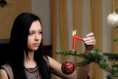 Young Woman with a Christmas tree Stock Photography
