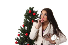Young woman with a christmas tree Royalty Free Stock Photo