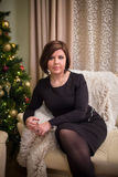 Young woman with christmas tree Stock Photos