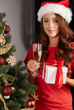 Young woman by a christmastree. And champagner Royalty Free Stock Photography