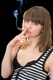 Young woman with a cigar Stock Image