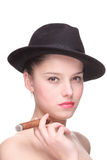 Young woman with a cigar Royalty Free Stock Image