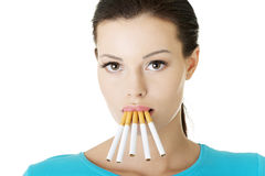 Young woman with cigarette in her mouth. Stock Photo