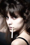 Young Woman with a Cigarette Stock Image