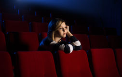 Young woman at the cinema Royalty Free Stock Photo