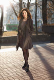 Young woman in city. Portait a beautiful young woman in the autumnal city Stock Photo