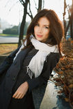 Young woman in city. Portait a beautiful young woman in the autumnal city Royalty Free Stock Images