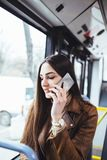 Young woman in city bus stock photography