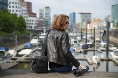Young woman in the city harbor Dusseldorf royalty free stock images