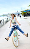 Young woman on a city retro bike having fun Royalty Free Stock Images
