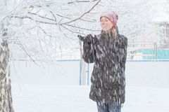 Young woman in the city in the snow Stock Photos