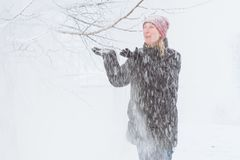 Young woman in the city in the snow Royalty Free Stock Photo