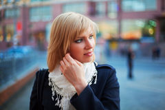 Young woman on a city street Stock Image