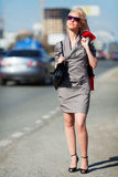Young fashion woman walking on the city street Royalty Free Stock Images