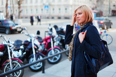 Young woman on the city street Stock Photography