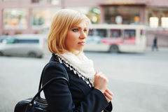 Young woman on a city street Stock Photography