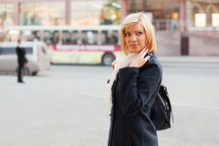 Young woman on a city street Stock Images