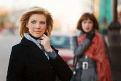 Young woman on a city street Royalty Free Stock Images