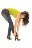 Young woman clasp her shoe. Young beautiful woman clasp her shoe Stock Image
