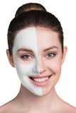 Young woman with clay face mask Stock Image