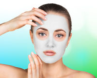 Young woman with clay face mask Royalty Free Stock Photography