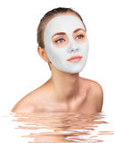 Young woman with clay face mask Royalty Free Stock Photos
