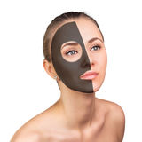 Young woman with clay face mask Stock Photo