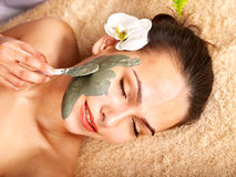 Young woman  with  clay facial mask. Stock Photo