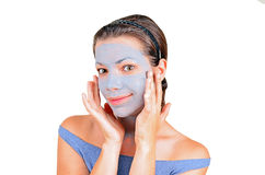 Young woman with clay facial mask Stock Photography