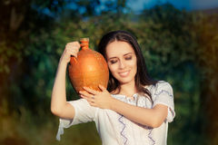Young Woman with Clay Pitcher Royalty Free Stock Image