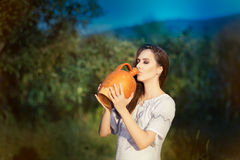 Young Woman with Clay Pitcher Royalty Free Stock Images