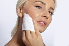 Young woman clean face with wet wipes Stock Photos