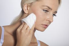 Young woman clean face with wet wipes Stock Photography