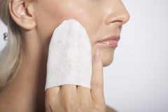 Young woman clean face with wet wipes Royalty Free Stock Photos